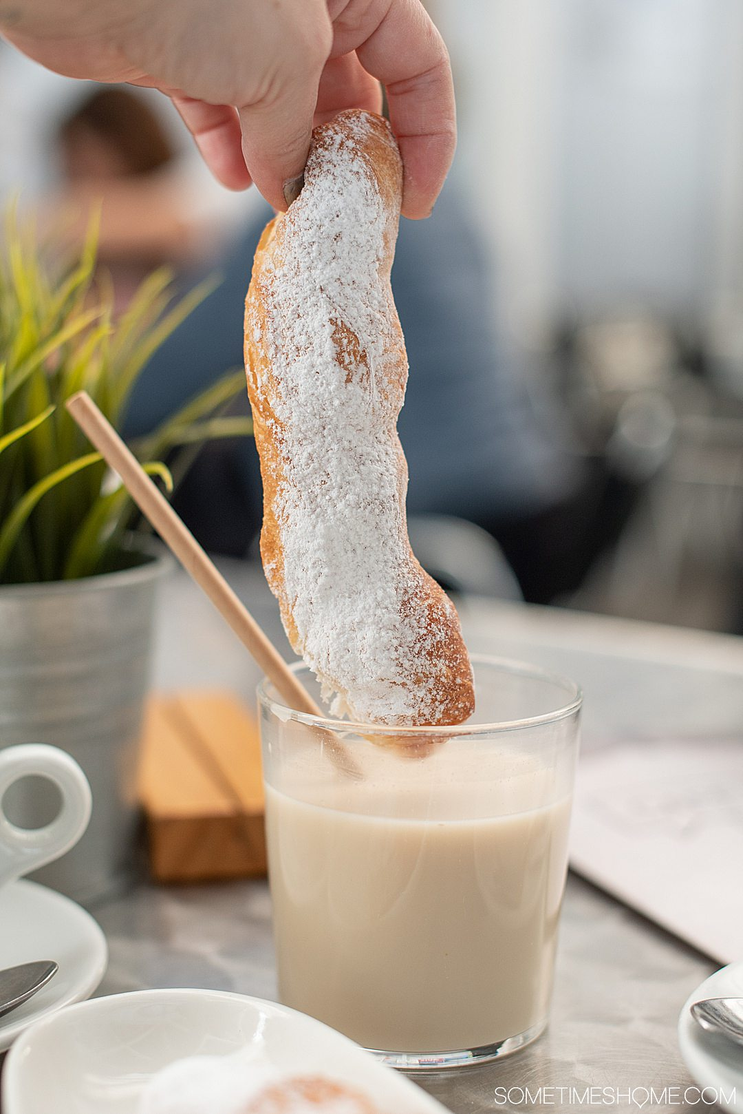 Glass of horchata, a typical Valencian drink, and pastry.