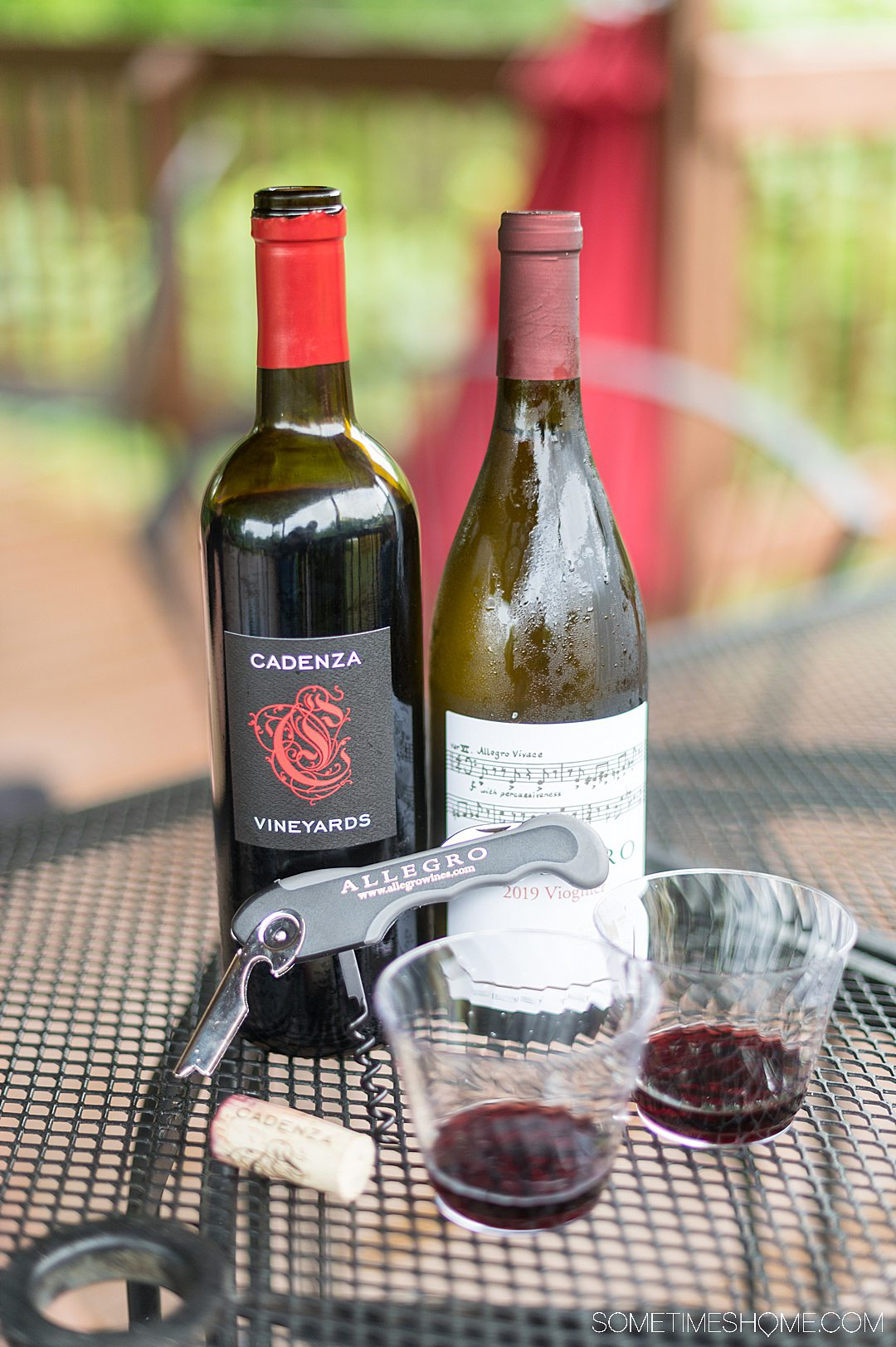 Bottles of wine, glasses and a wine opener