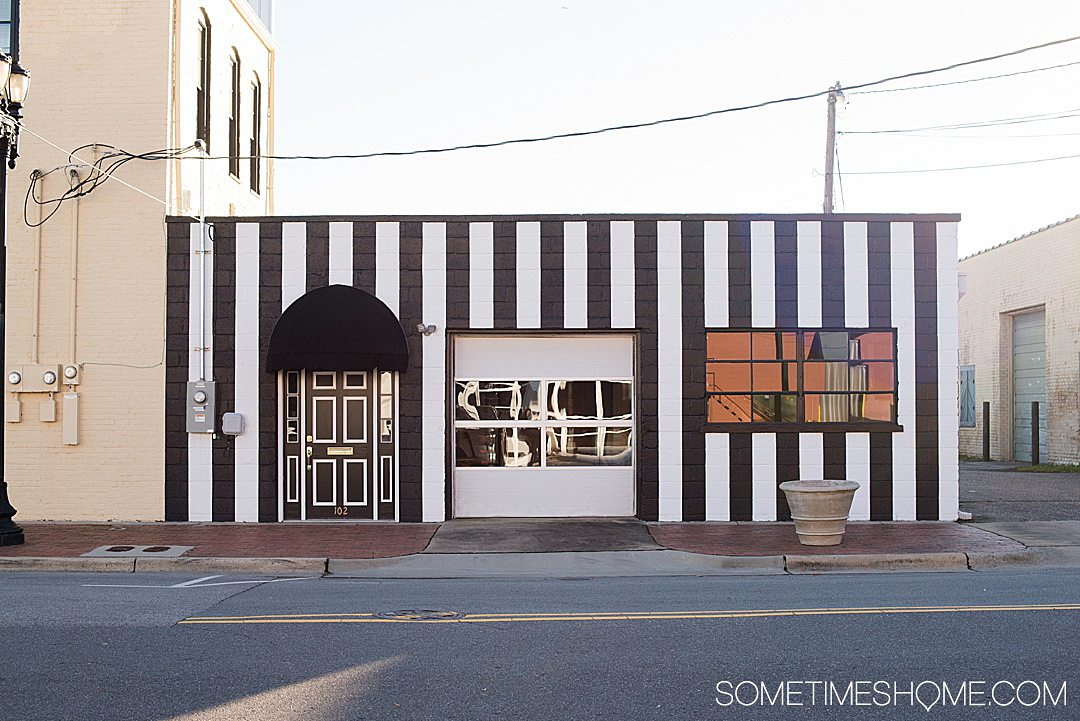 Vertical black and white striped facade of Goldsboro NC store