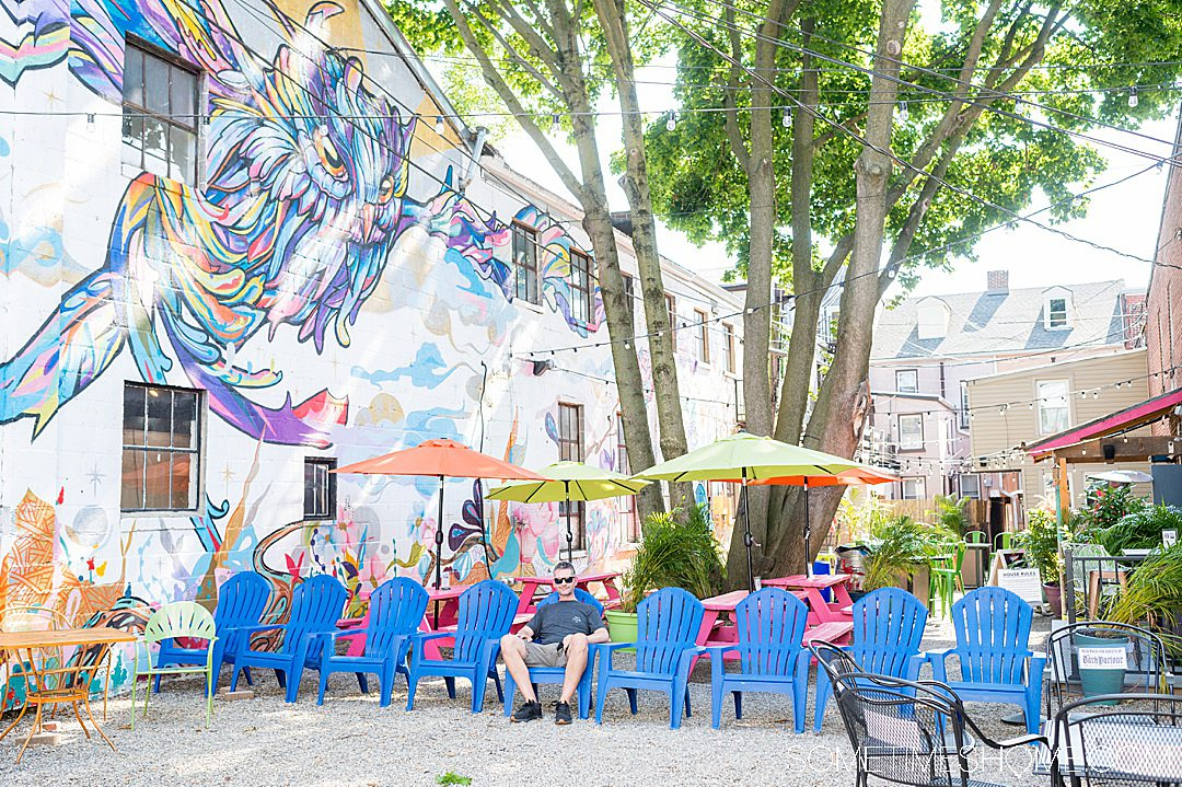 Owl mural painting in a colorful courtyard