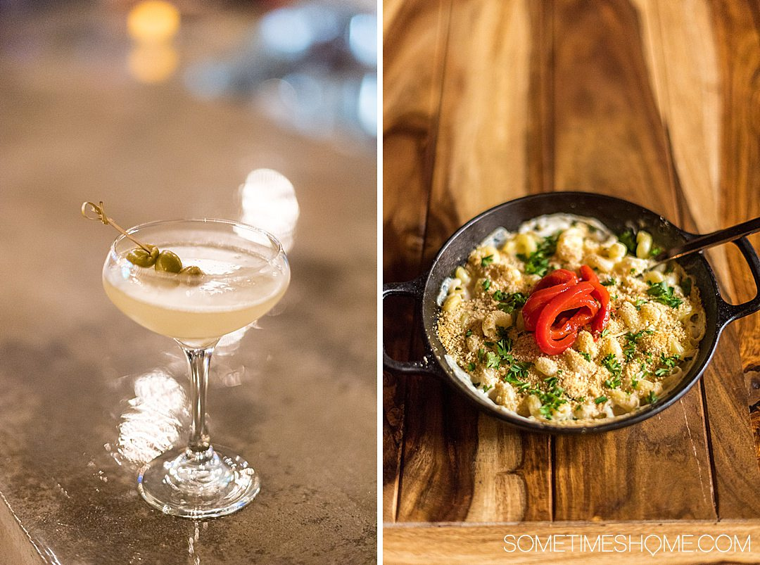 Dirty martini cocktail and macaroni and cheese in an iron skillet