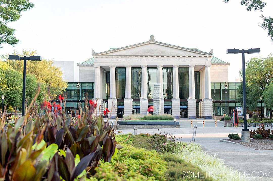Building in downtown Raleigh with multiple columns and a triangle roof. Landscaping is in the foreground of the photo.