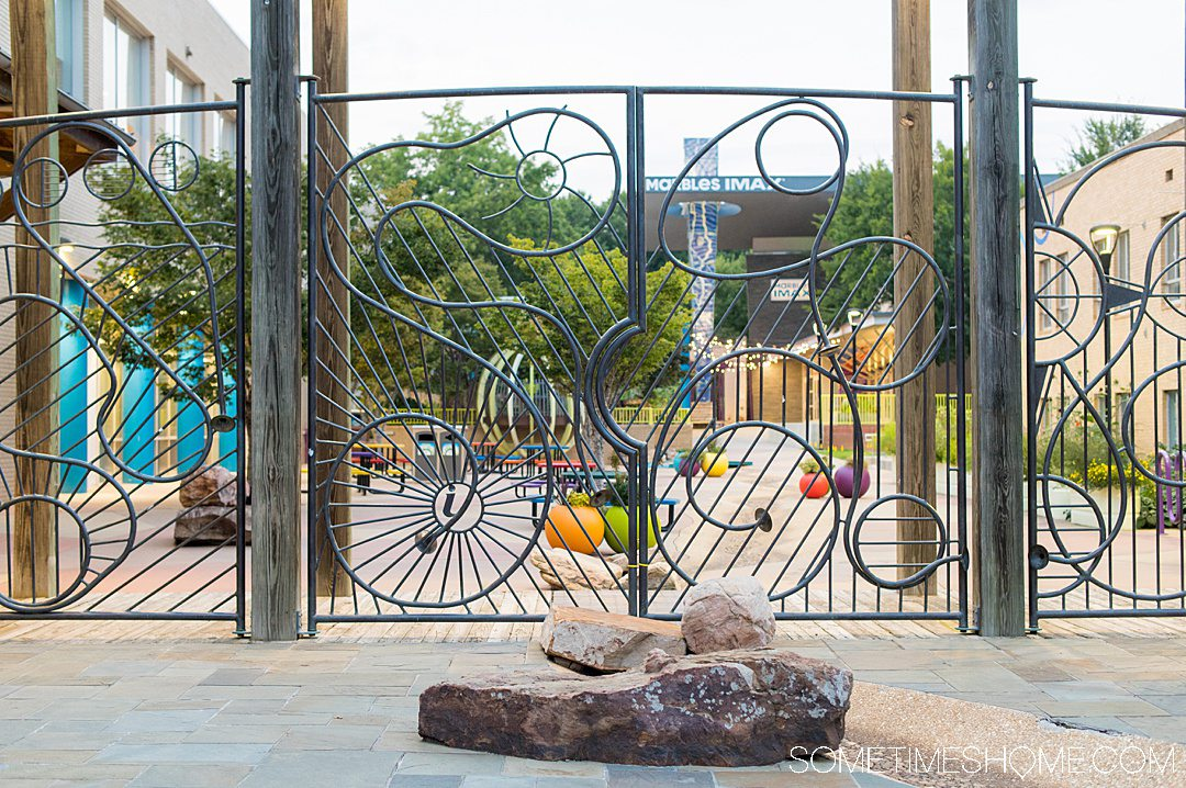 Whimsical iron gate and fence in front of the Marbles Kids Museum in downtown Raleigh, a great place to take pictures.