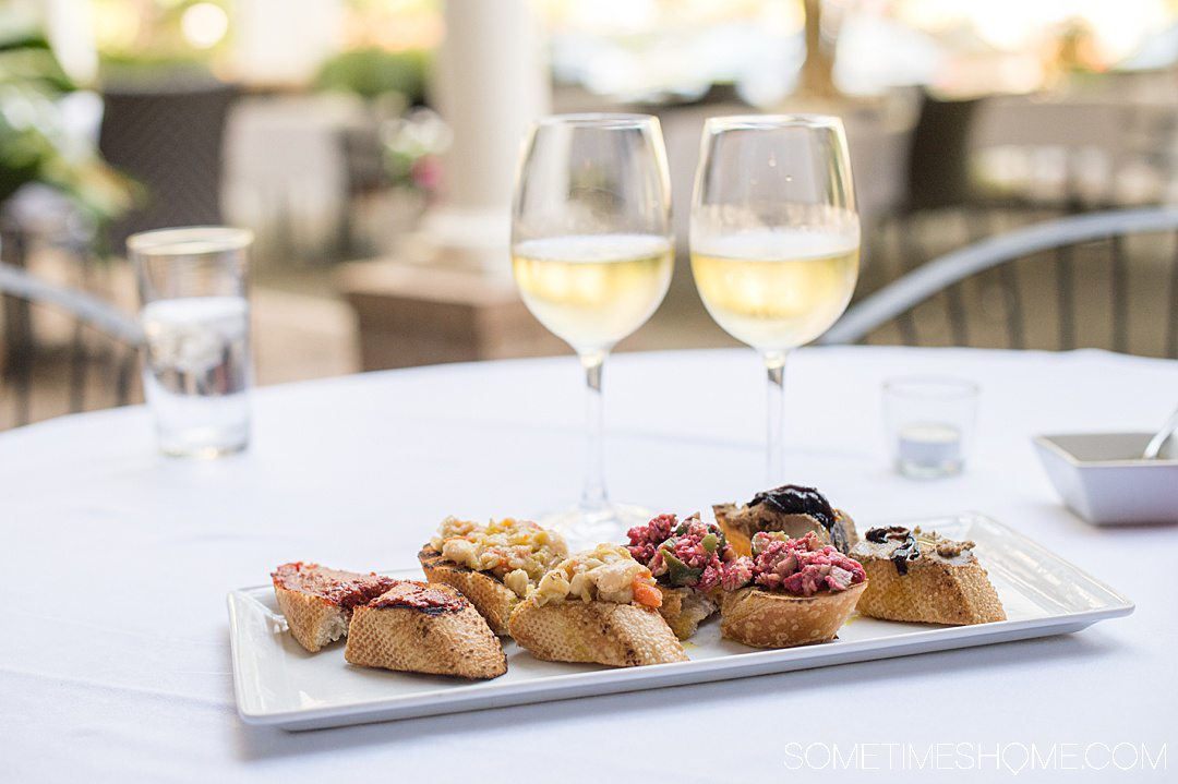 Plate of crostinis and white wine.
