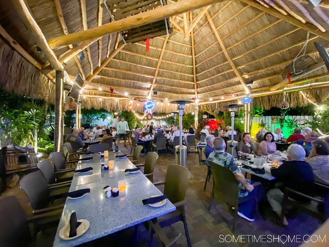 Outdoor patio with a thatched roof at the Lazy Lobster restaurant in Key Largo at the Florida Keys.
