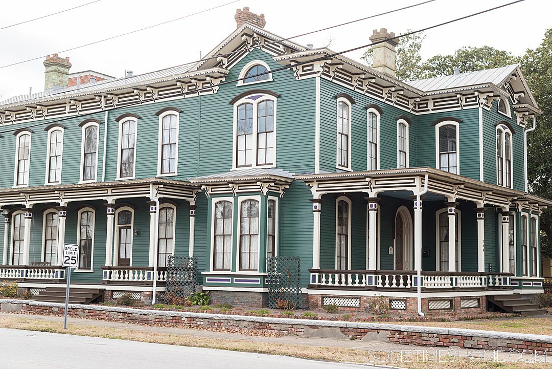 Victorian style home painted green, white and black in Goldsboro, NC