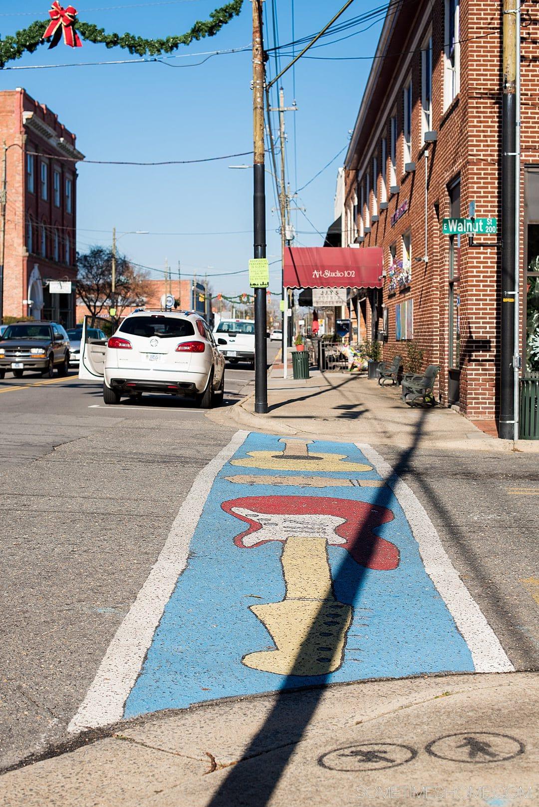 Guitar painted in a crosswalk