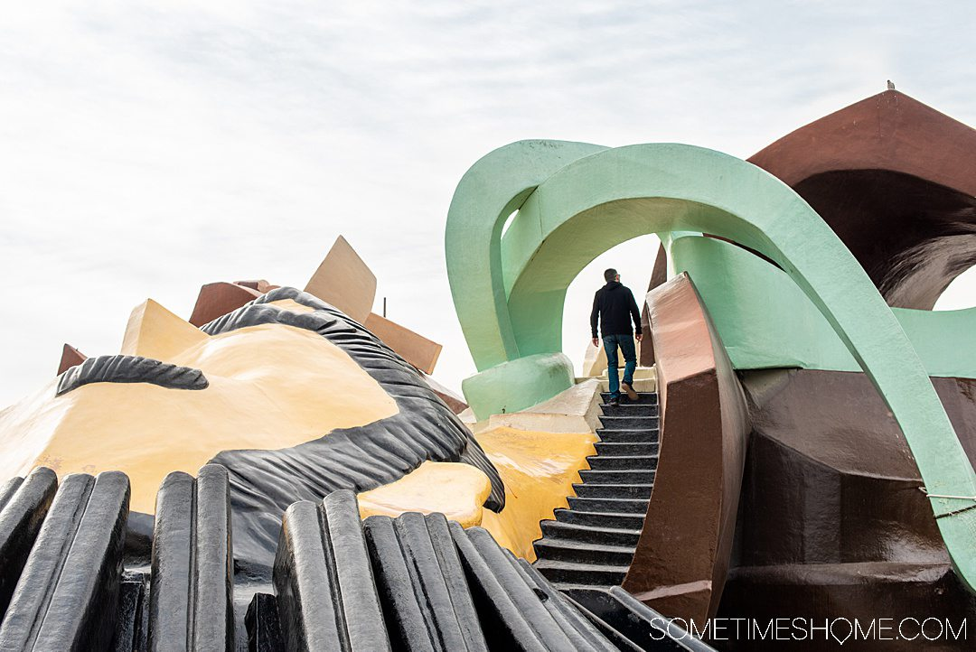 A playful photo of a man climbing stairs in a playground