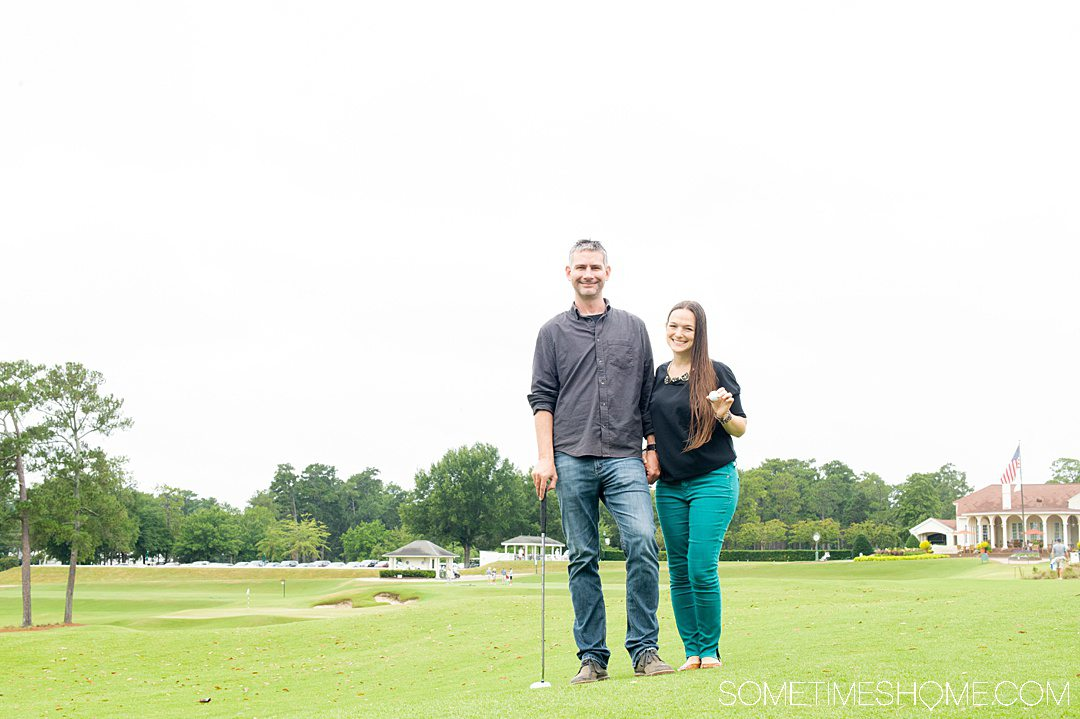 A man and a woman standing on a golf course in Pinehurst, NC.