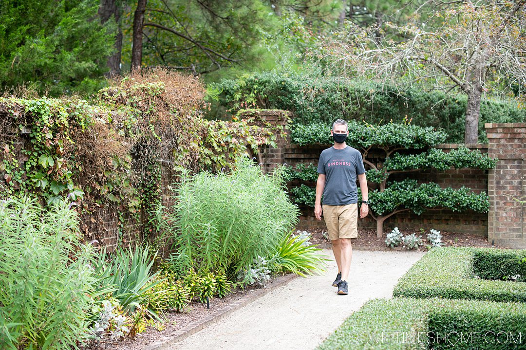 A man walking through a garden in Southern Pines, NC.