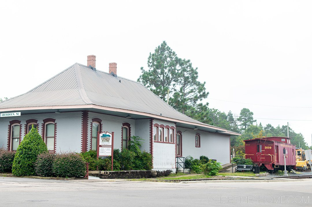 Grey building train station in Aberdeen, NC.