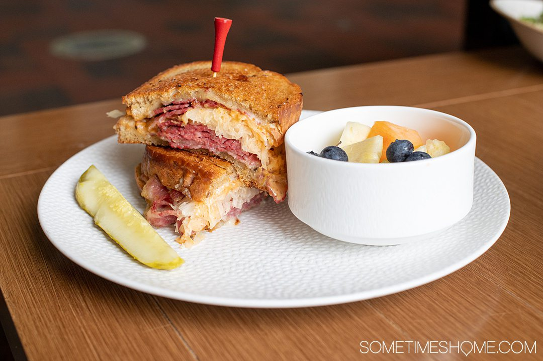 Photo of a Reuben sandwich and fruit cup at The Deuce restaurant in Pinehurst, NC.