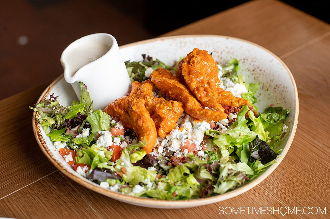 Photo of a grilled Buffalo chicken salad at The Deuce restaurant in Pinehurst, NC.
