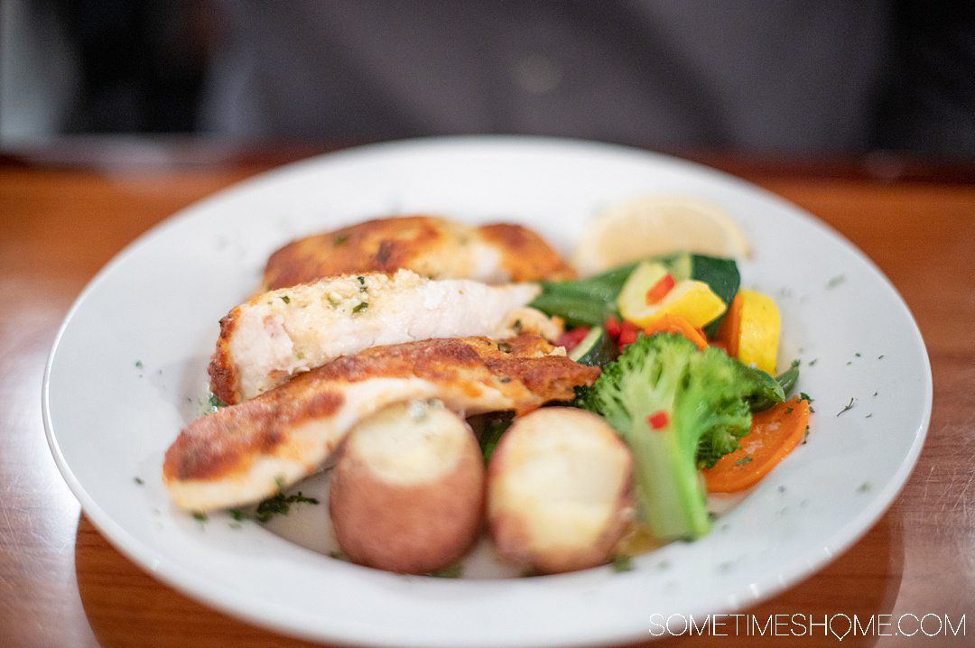 A plate of steamed vegetables and potatoes with parmesan crusted Grouper at Dinky's restaurant in Hatteras.