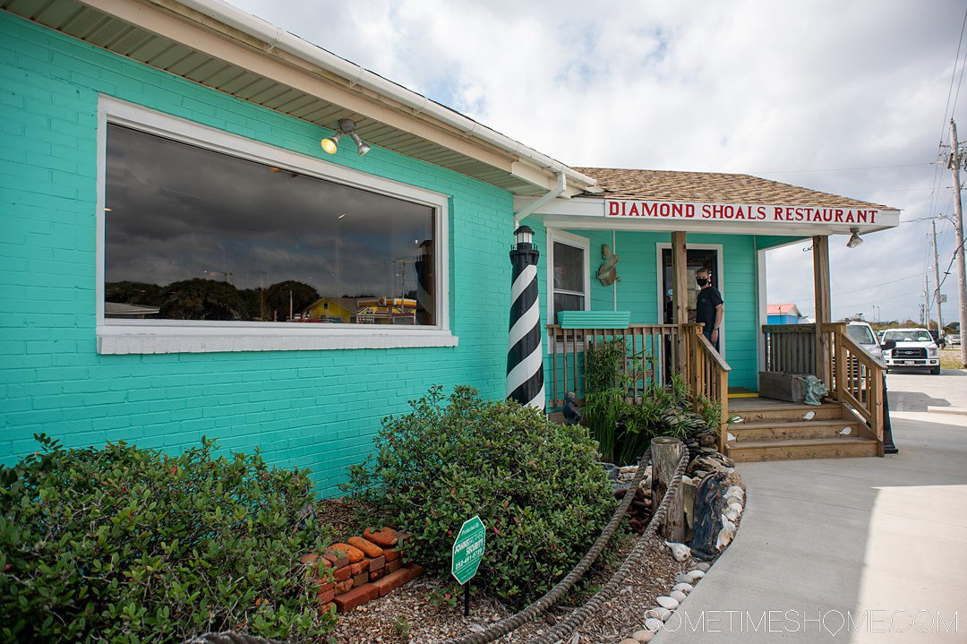 Blue facade of a restaurant in Hatteras, called Diamond Shoals.