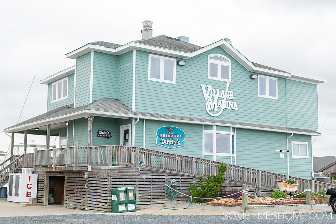 Exterior of the Village Marina building where Dinky's restaurant is in the Outer Banks.