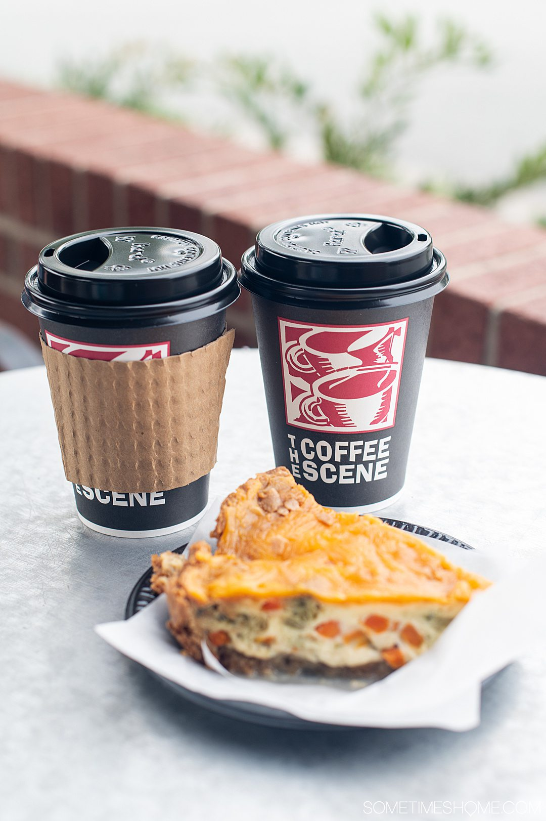 "Coffee cups that read, ""The Coffee Scene"" and a piece of breakfast quiche as one of our date ideas in Fayetteville, NC."
