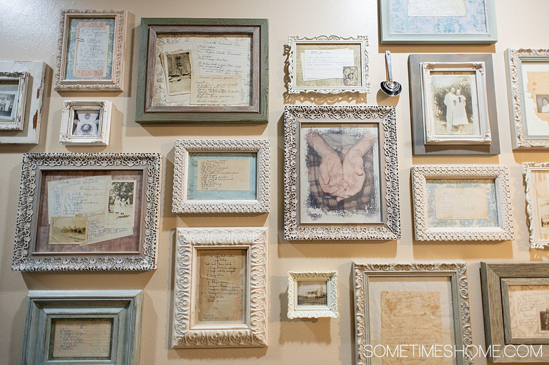 A wall of framed old photographs and hand written recipes at Fayetteville Pie Company in North Carolina.