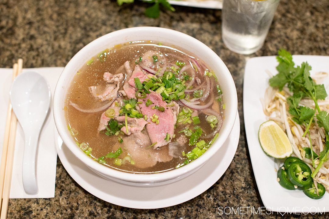 Bowl of rare beef pho in Fayetteville, NC restaurant Grilled Ginger.