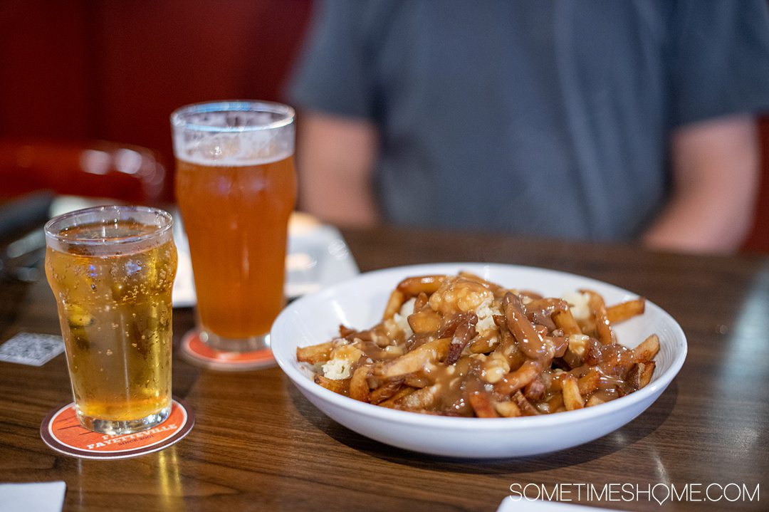 Bowl of French fries, gravy and cheese curd poutine at restaurant and brewery Mash House in Fayetteville, NC.