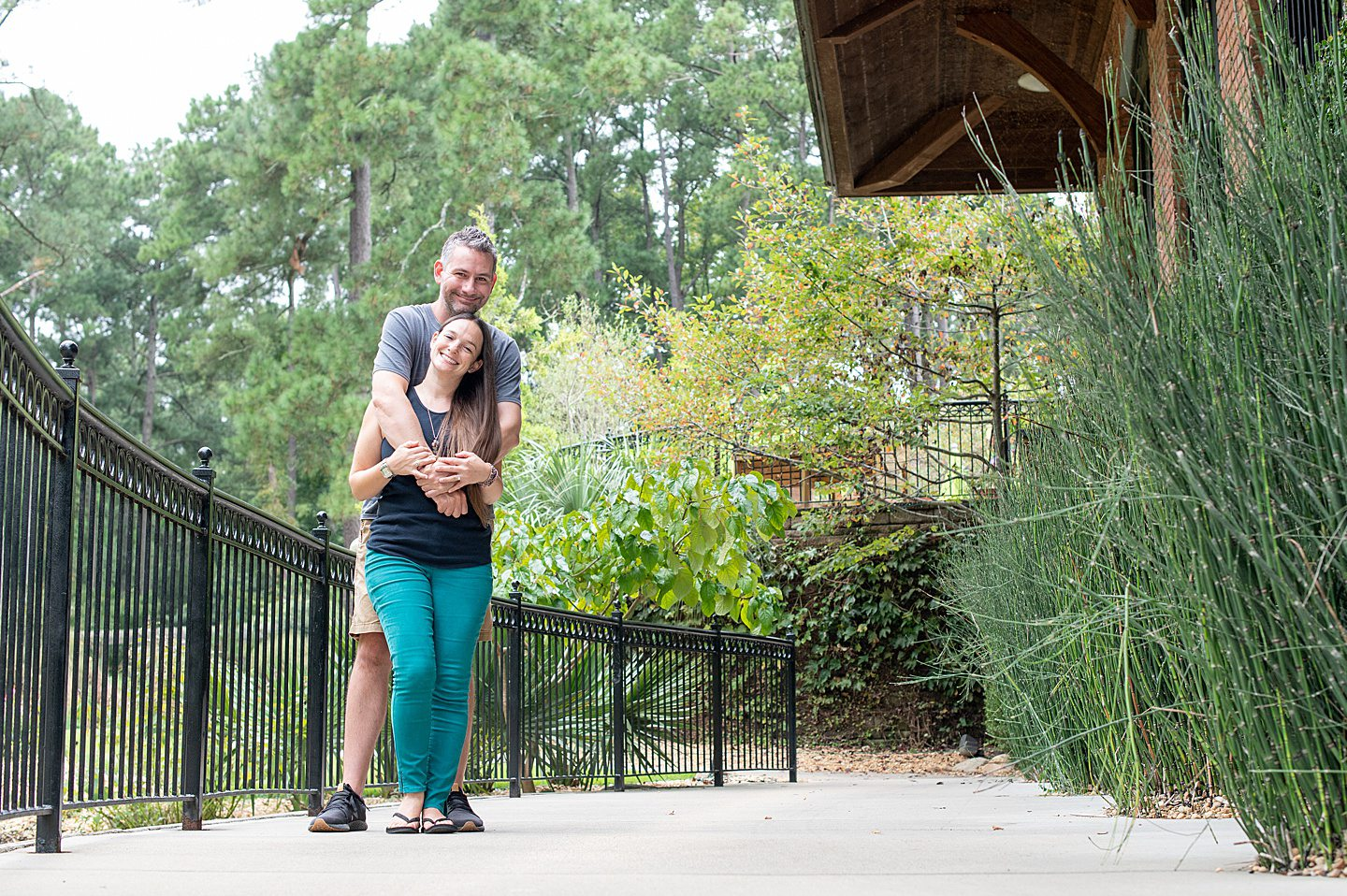 A couple embracing at Cape Fear Botanical Garden in Fayetteville, NC
