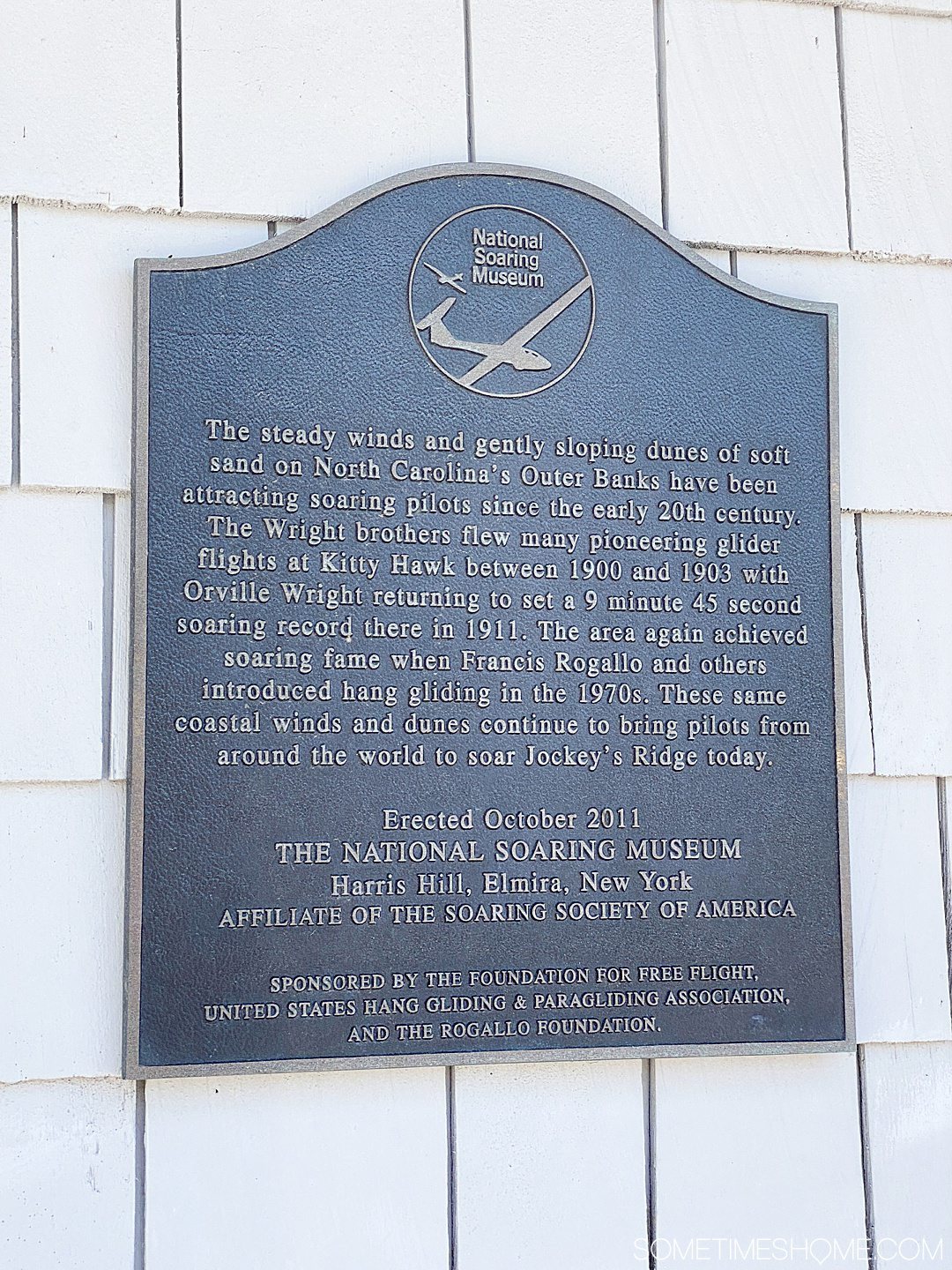 A plaque about flying and the history of flight at Jockey's Ridge State Park in Nags Head of the Outer Banks in NC.