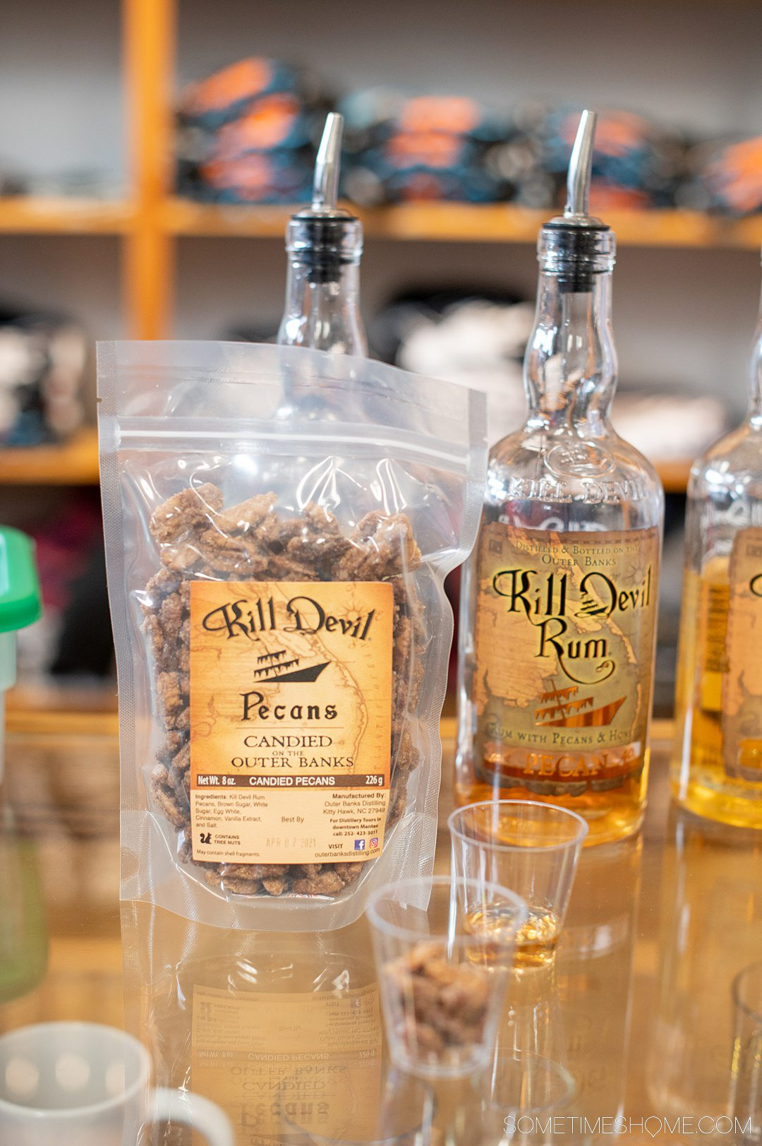 A bag of candied pecans next to a bottle of rum at Outer Banks Distilling in North Carolina.