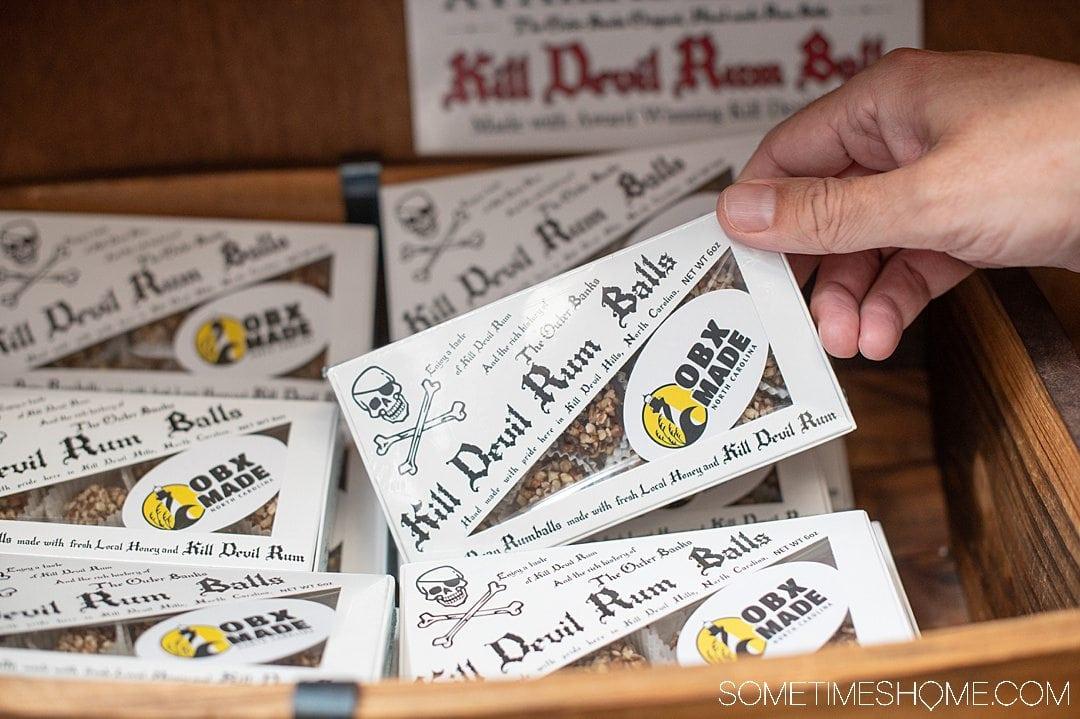White boxes of Kill Devil Rum Balls with black lettering.