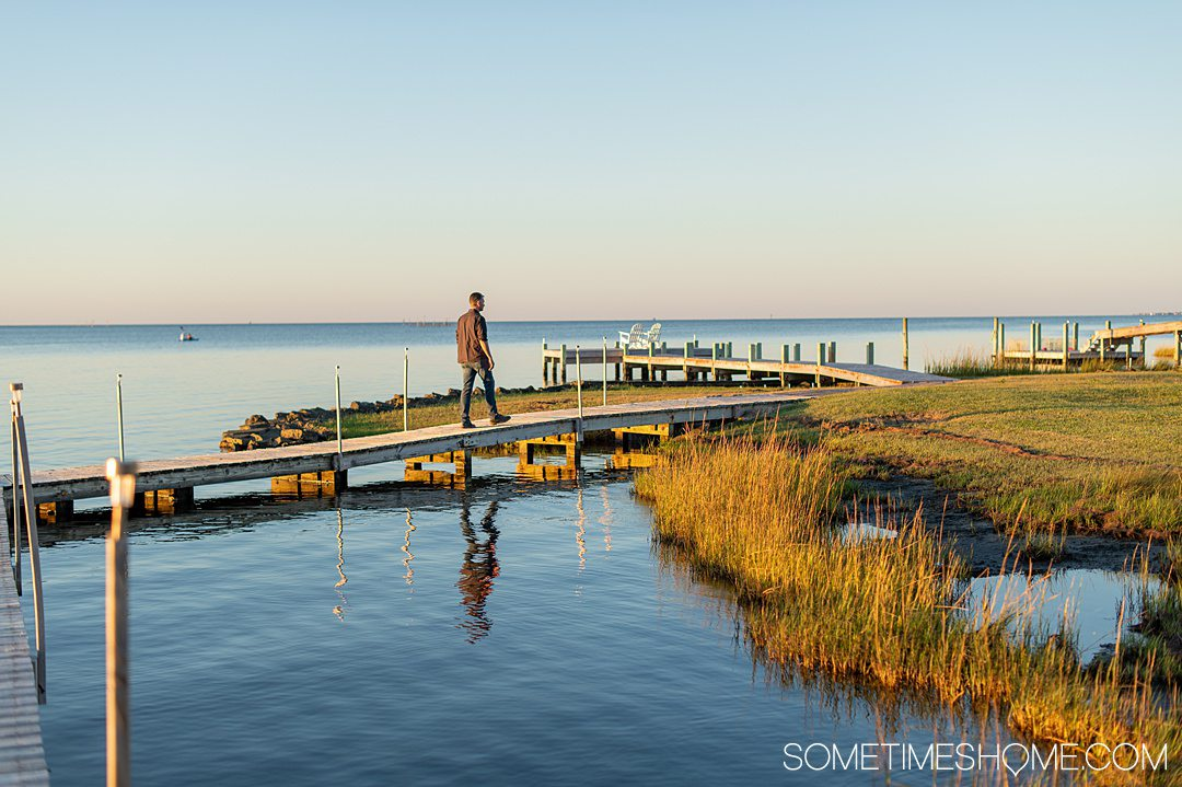 October in the Outer Banks in NC, with a man walking on a dock on the Inn on Pamlico Sound.