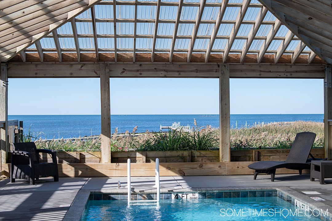 Pool inside a wooden structure with a view out to the sound at the Inn on Pamlico Sound.