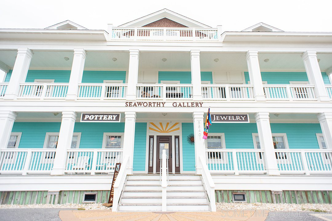 """Blue and white art gallery building in the Outer Banks that reads """"Seaworthy Gallery"""" on the outside."""