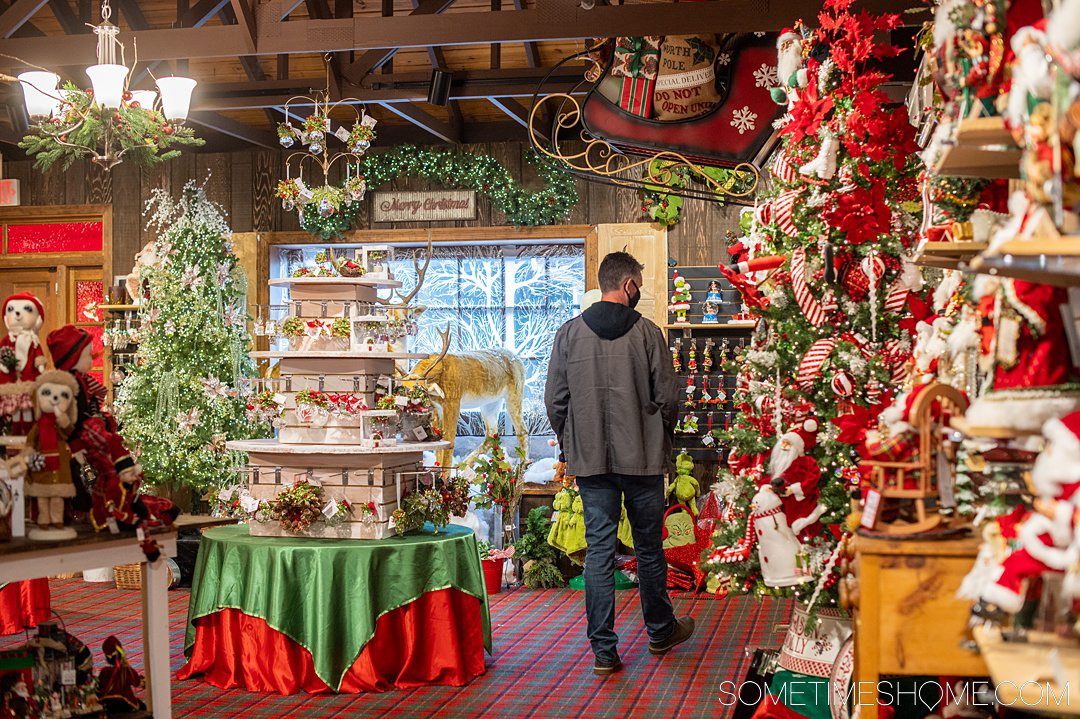 A man browsing the items at a Christmas shop in the Outer Banks.