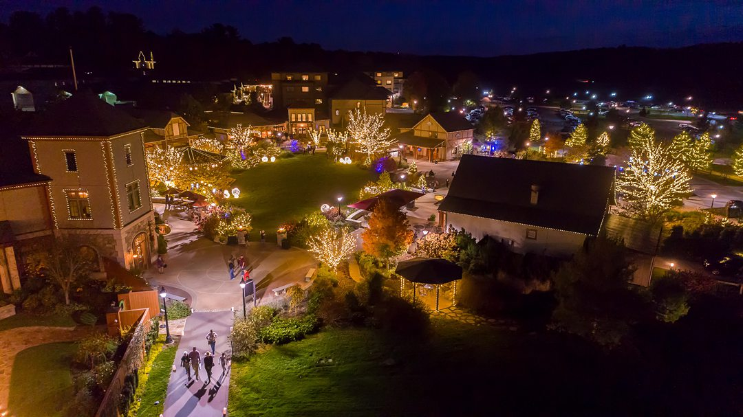 Exterior of The Biltmore village in Asheville, NC, decorated with Christmas lights.