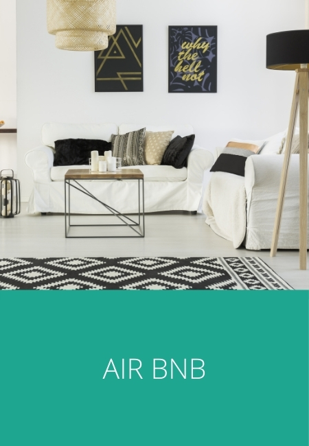 Air BnB graphic with a photo of the inside of an apartment.