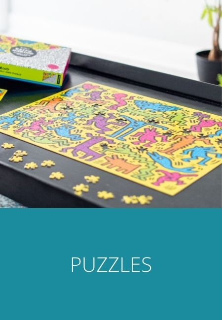 Puzzles graphic with a photo of a colorful Keith Haring puzzle.