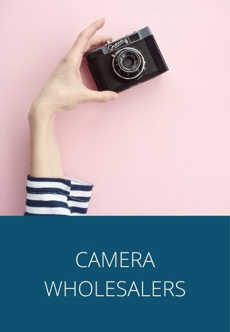 Camera wholesalers text with a photo of a female's hand holding a black camera against a pink backdrop.