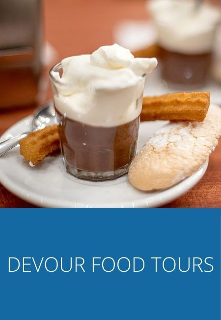 Devour Food Tours graphic with hot chocolate and churro, and a Madeline cookie.