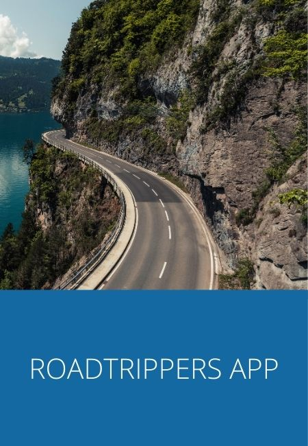 Photo of a coastal road on the side of a mountain wth the words Roadtrippers App under it.