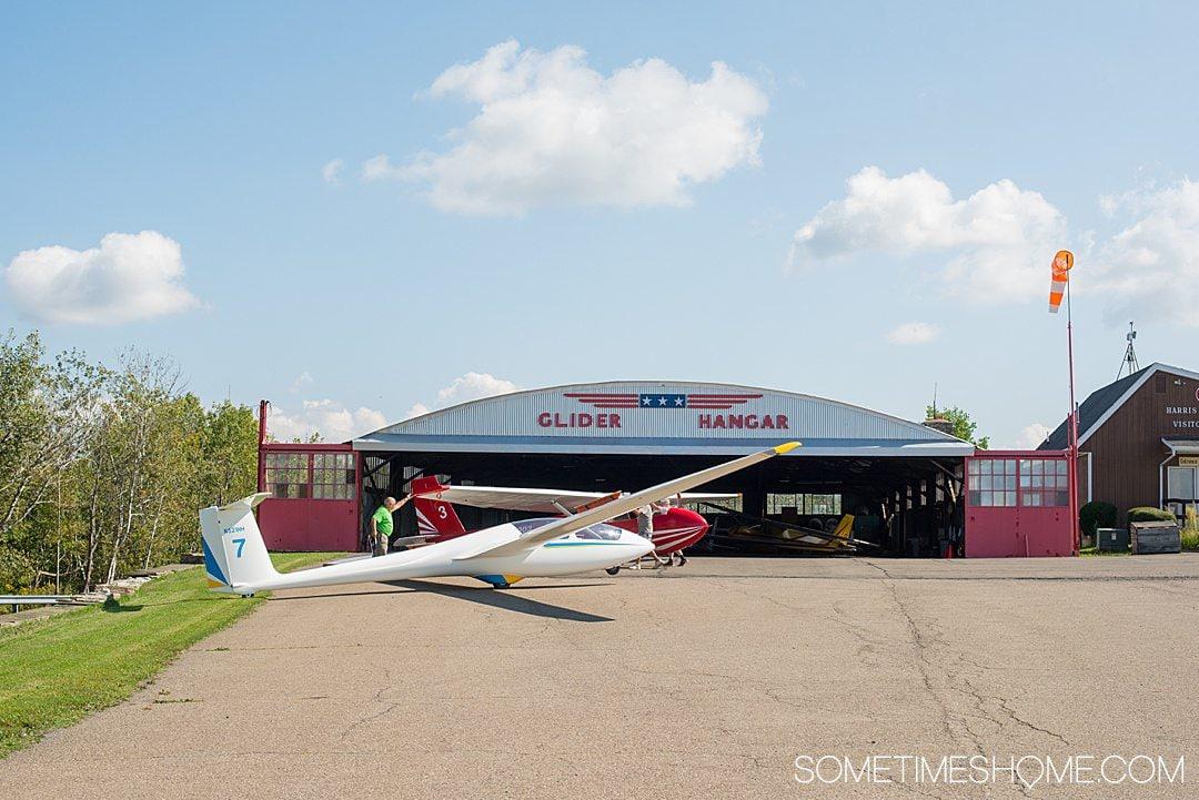 White hang glider in the Finger Lakes of New York.