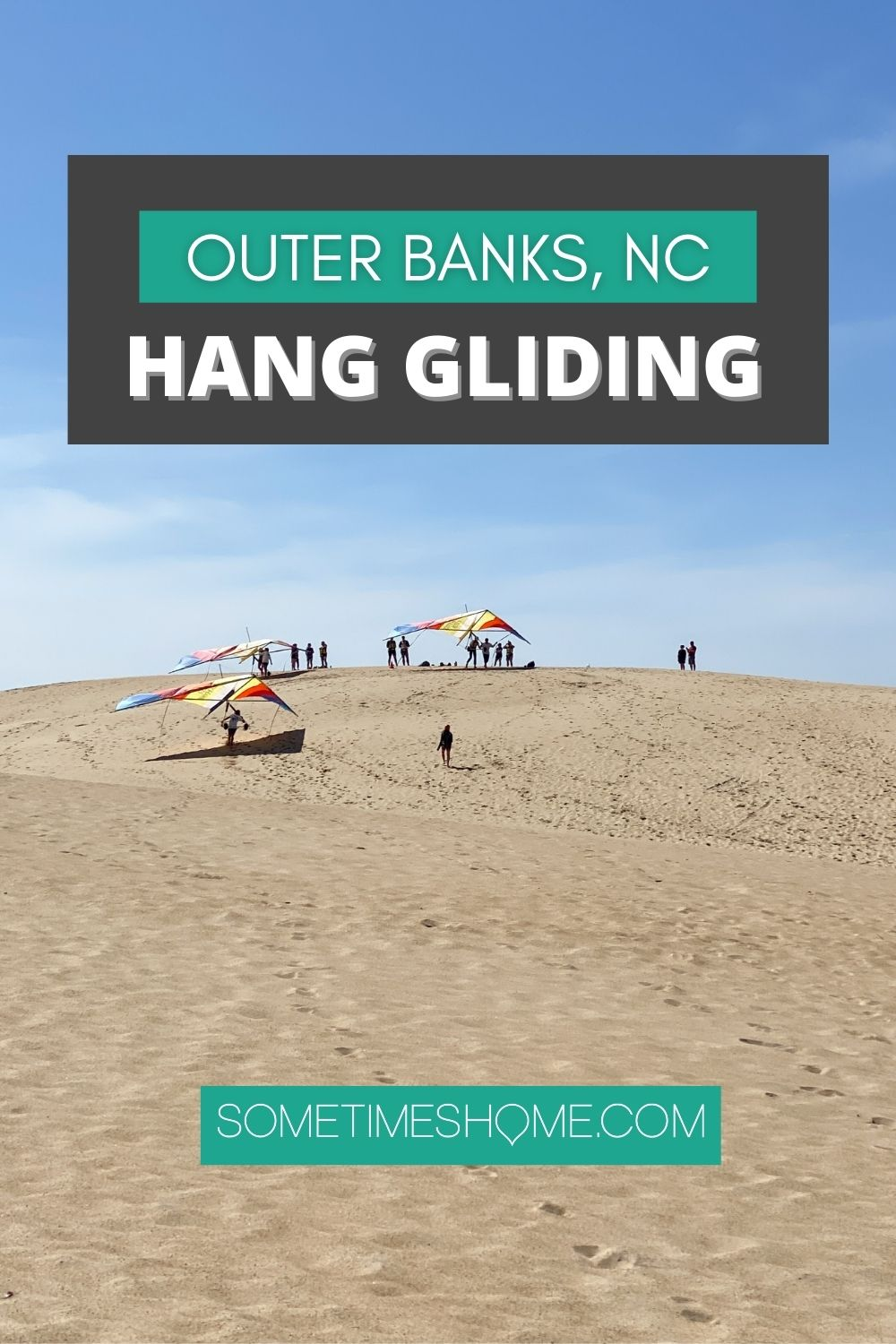 Hang Gliding in the Outer Banks of North Carolina Pinterest image with a photo of hang gliders and sand dunes behind the text.