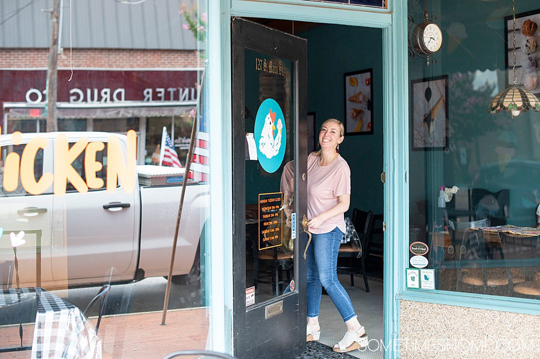 Things to do in Warrenton: visit Chilly Chicken Creamery! Photo of a woman passing through the door to the shop.