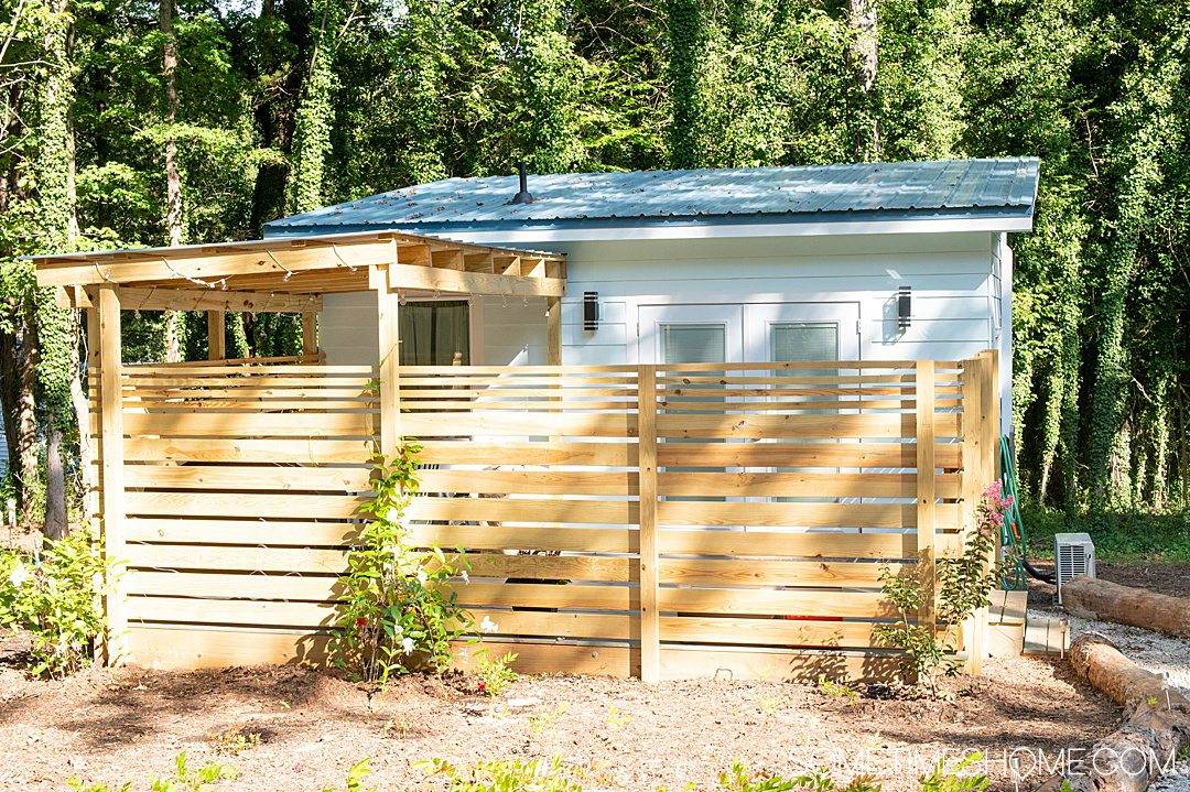 Places to stay in Warrenton, NC: Tiny Home Air BnB with a wooden fence out front.