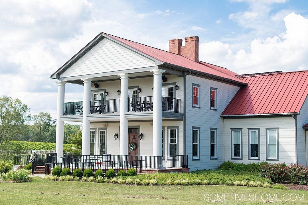 Rosemont vineyard wine two-story house with balconies on both floors in Virginia.
