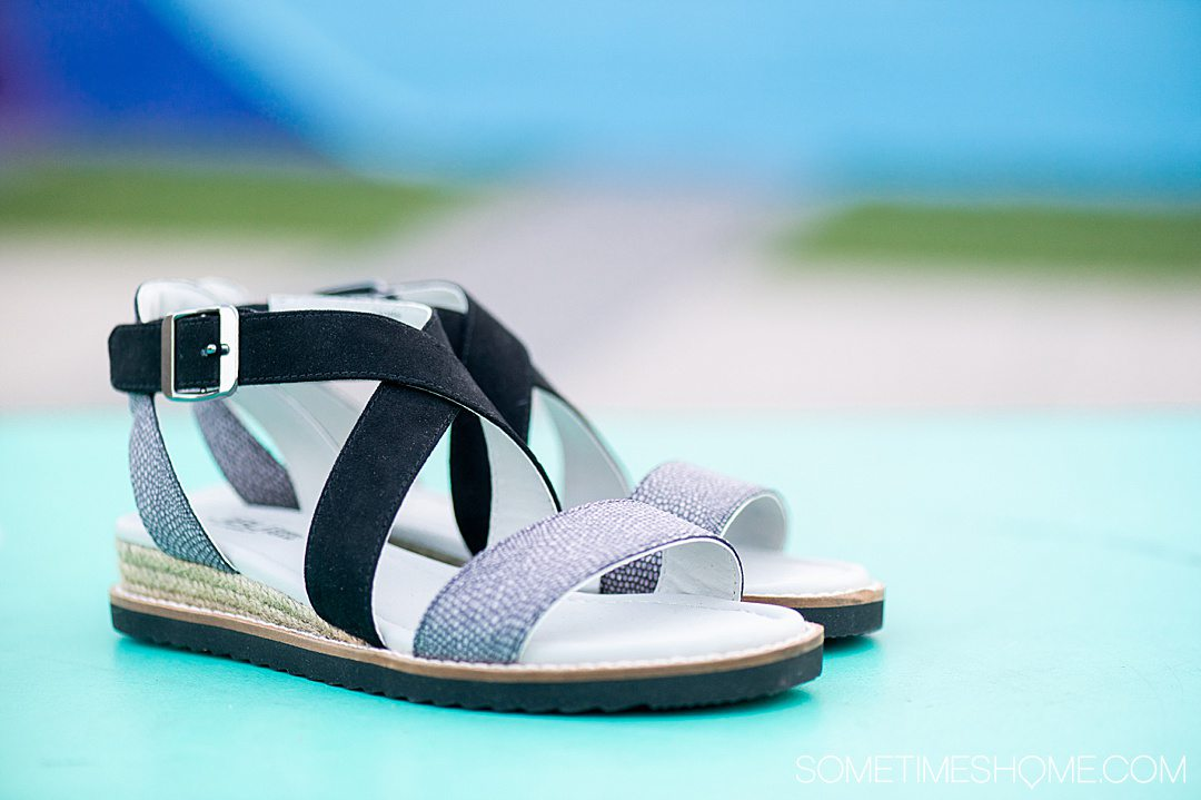 Black and grey decoration pair of Jambu shoes sandals for a review post.