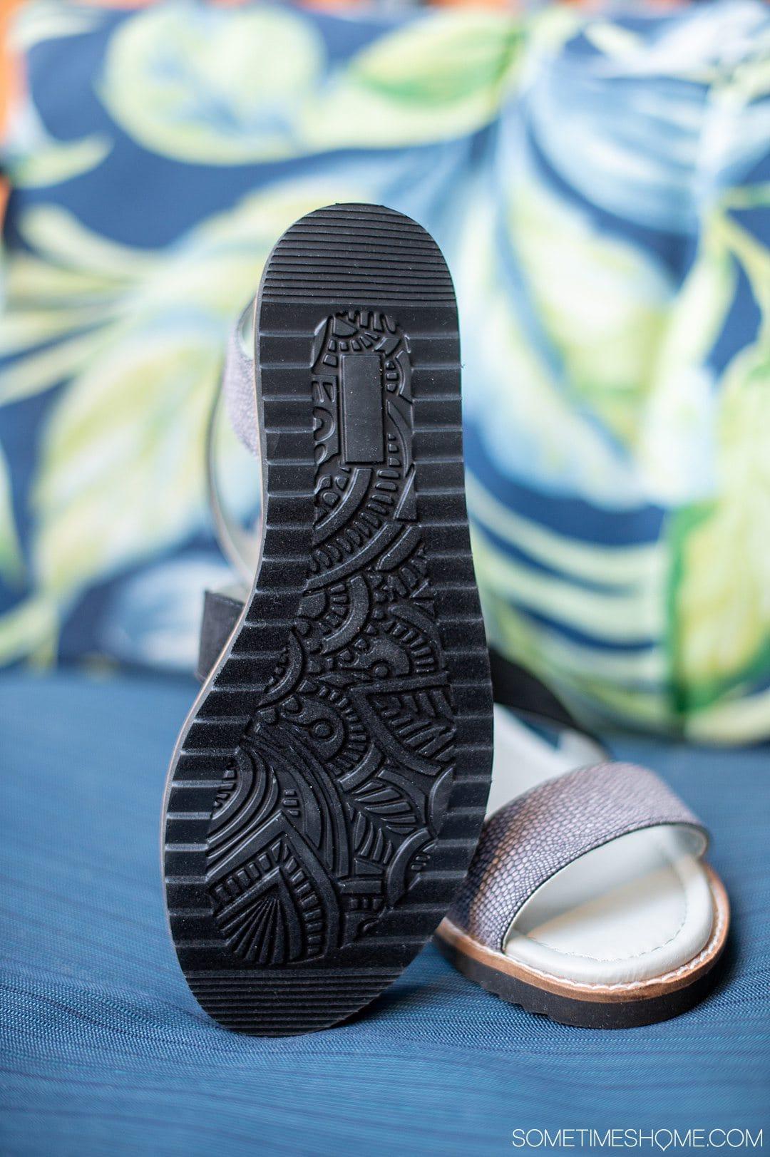 Black decorative bottom soles of a pair of Jambu shoes sandals.