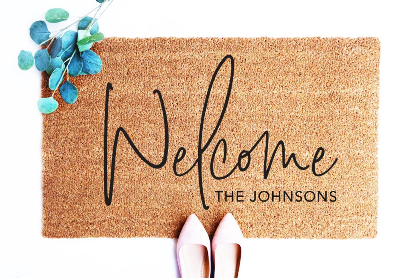 """Welcome mat with """"The Johnsons"""" in the lower right hand corner from an Etsy shop."""