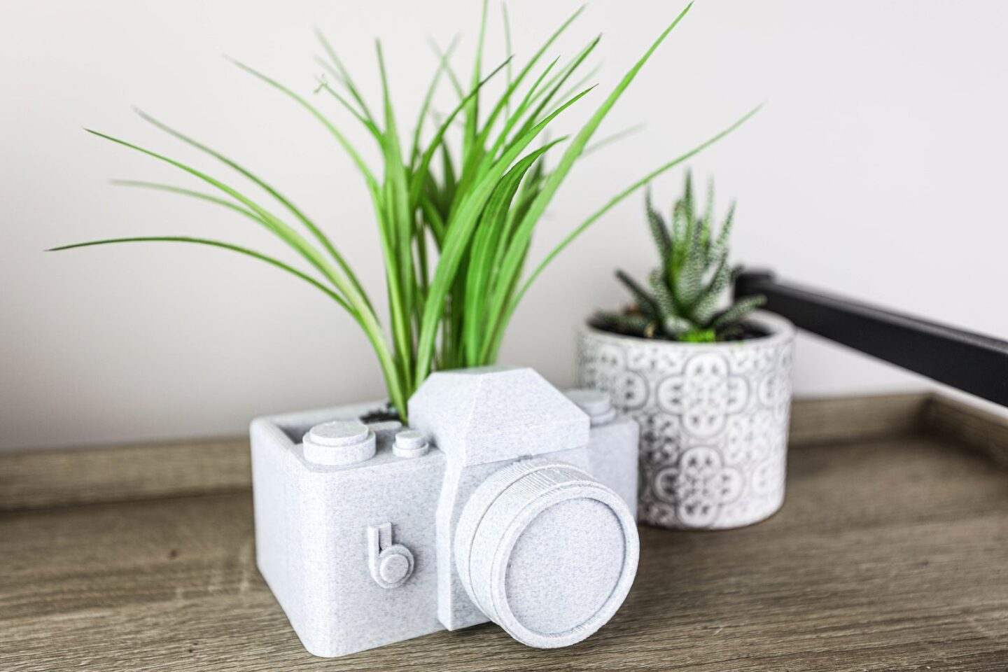 Small camera planter in granite style material from Etsy.