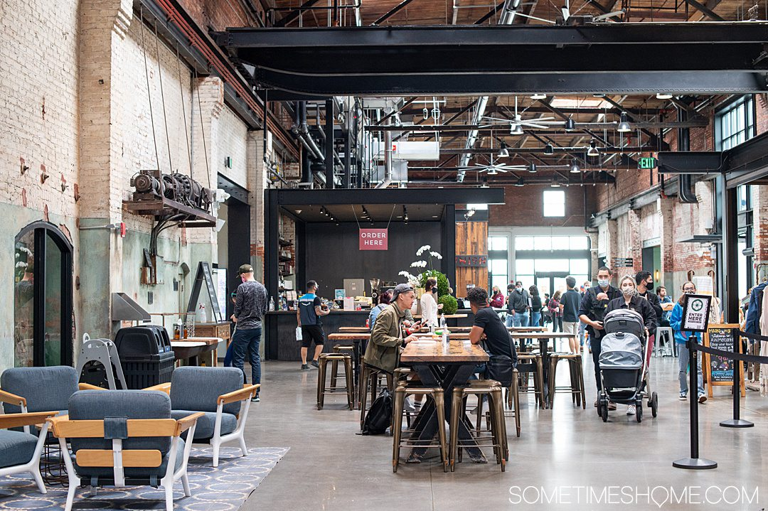 Industrial inspired interior of Armature Works food hall in Tampa, Florida.
