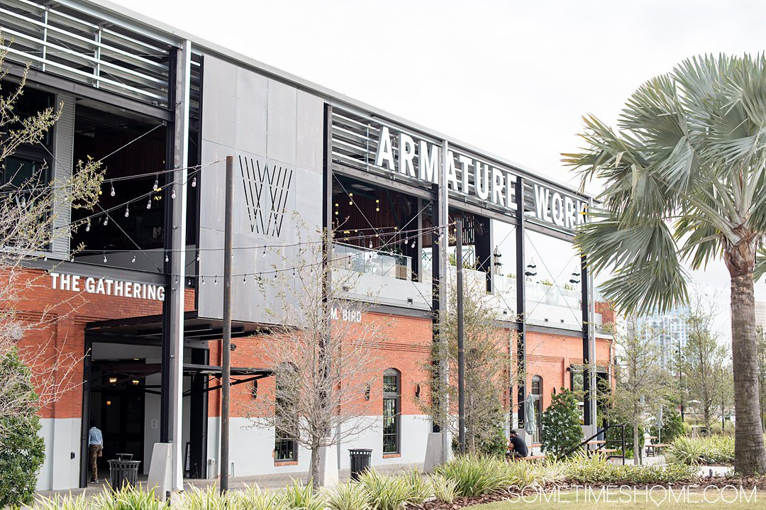 Brick and metal exterior of Armature Works food hall in Tampa Bay.