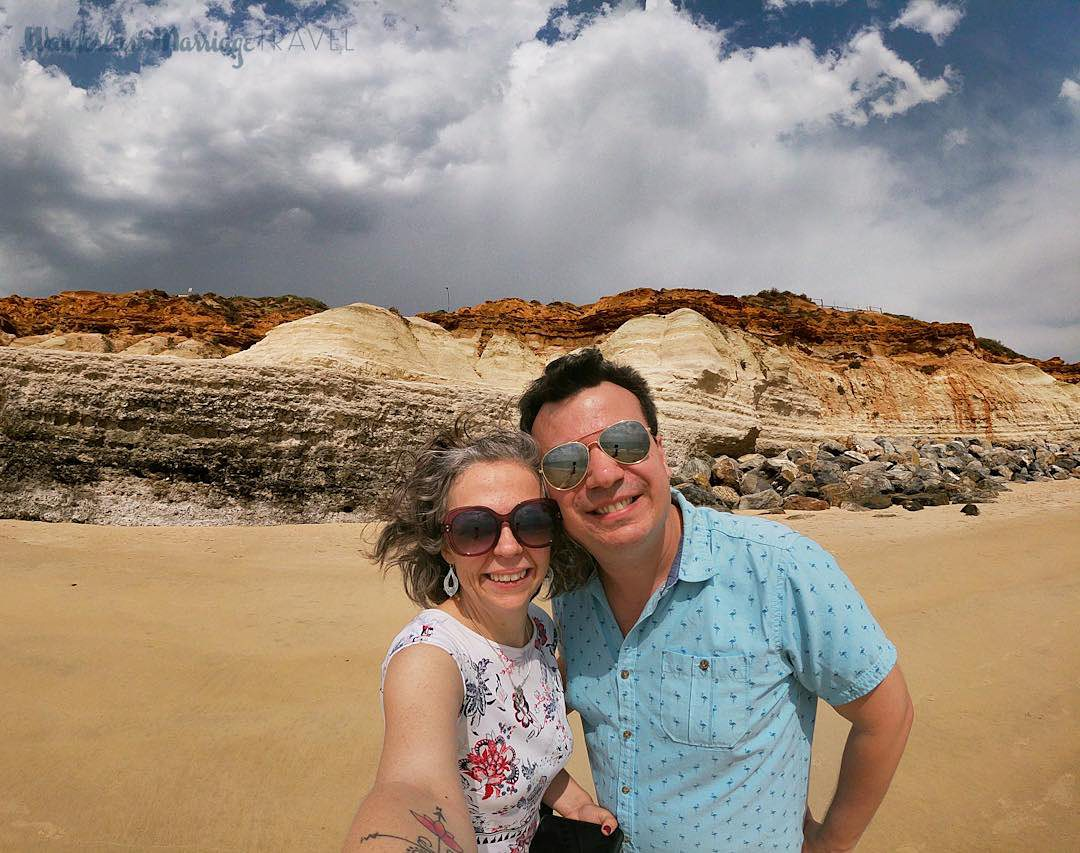 Couple in front of a plateau and blue sky.